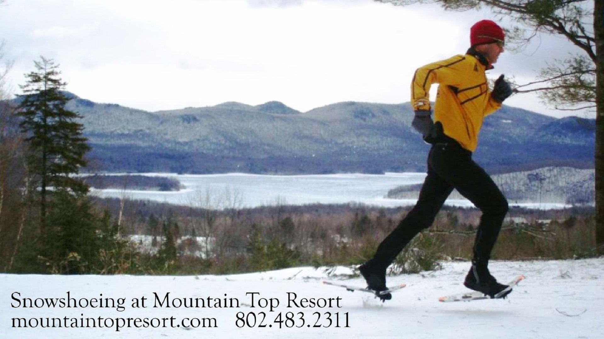 A man is cross country skiing in the snow at The Mountain Top Inn & Resort.