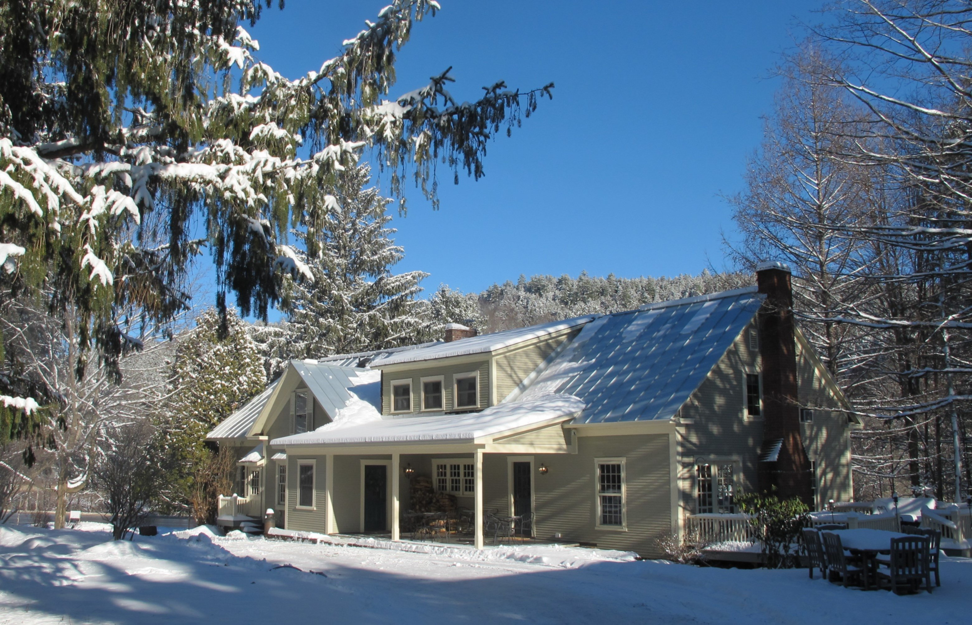 A house covered in snow at Featherbed Inn.