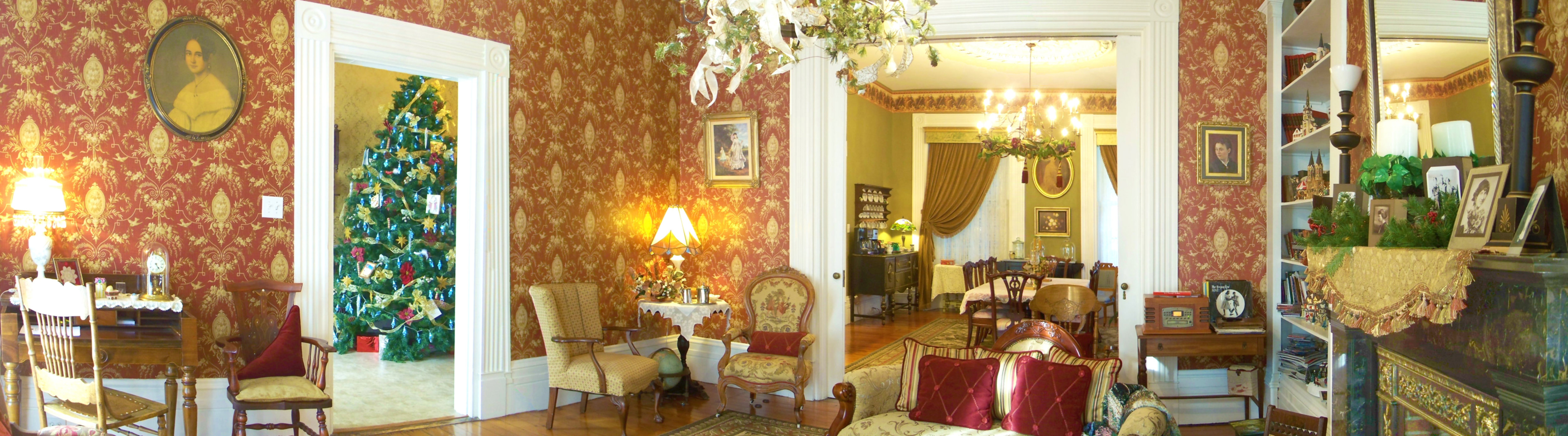 A living room filled with furniture and a fire place at Azalea Manor Bed & Breakfast.