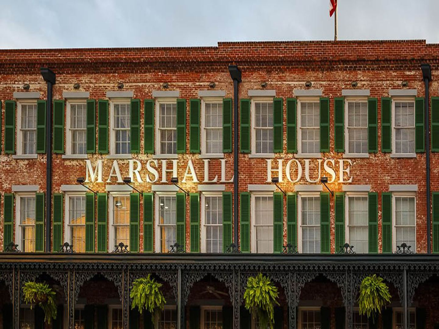 A sign in front of a building at The Marshall House.