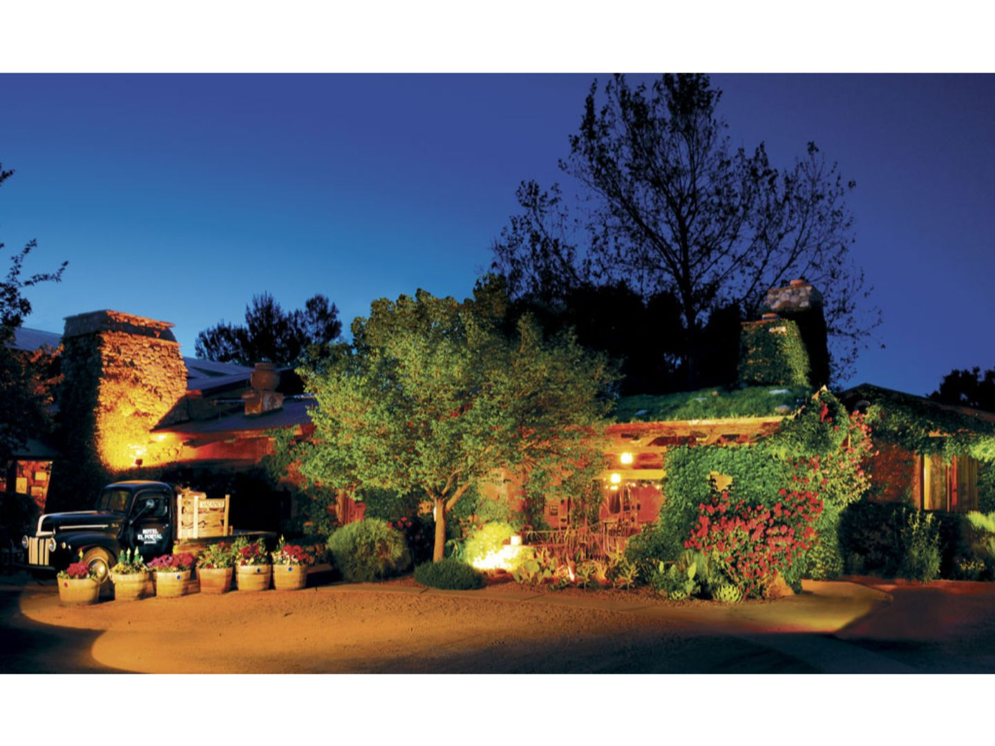 A house with trees in the background at El Portal Sedona Hotel.