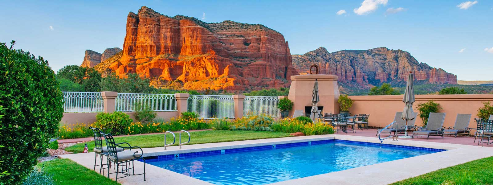 A pool next to a body of water at Canyon Villa Bed & Breakfast.