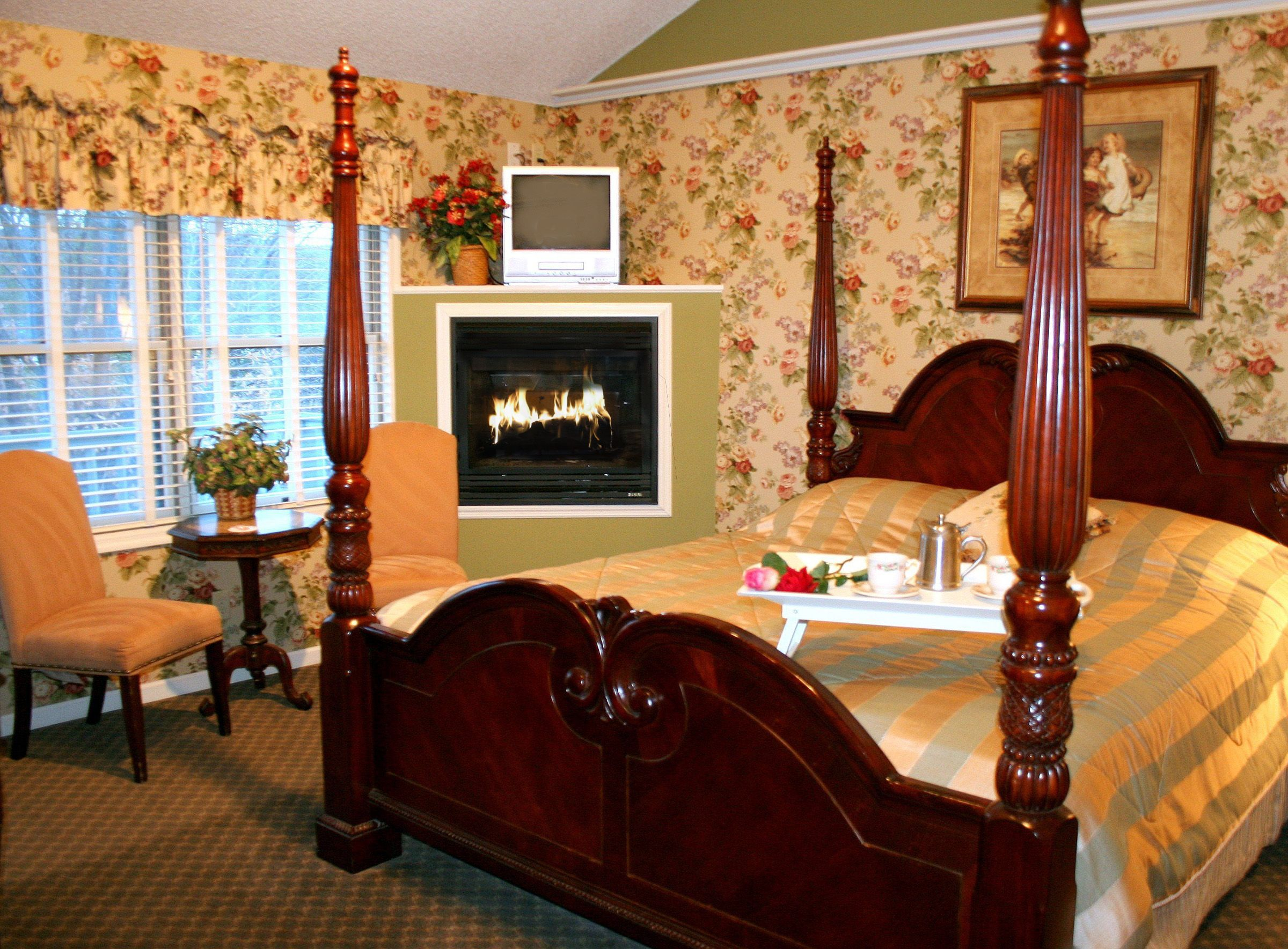 A living room filled with furniture and a fire place sitting in a chair at Afton House Inn.