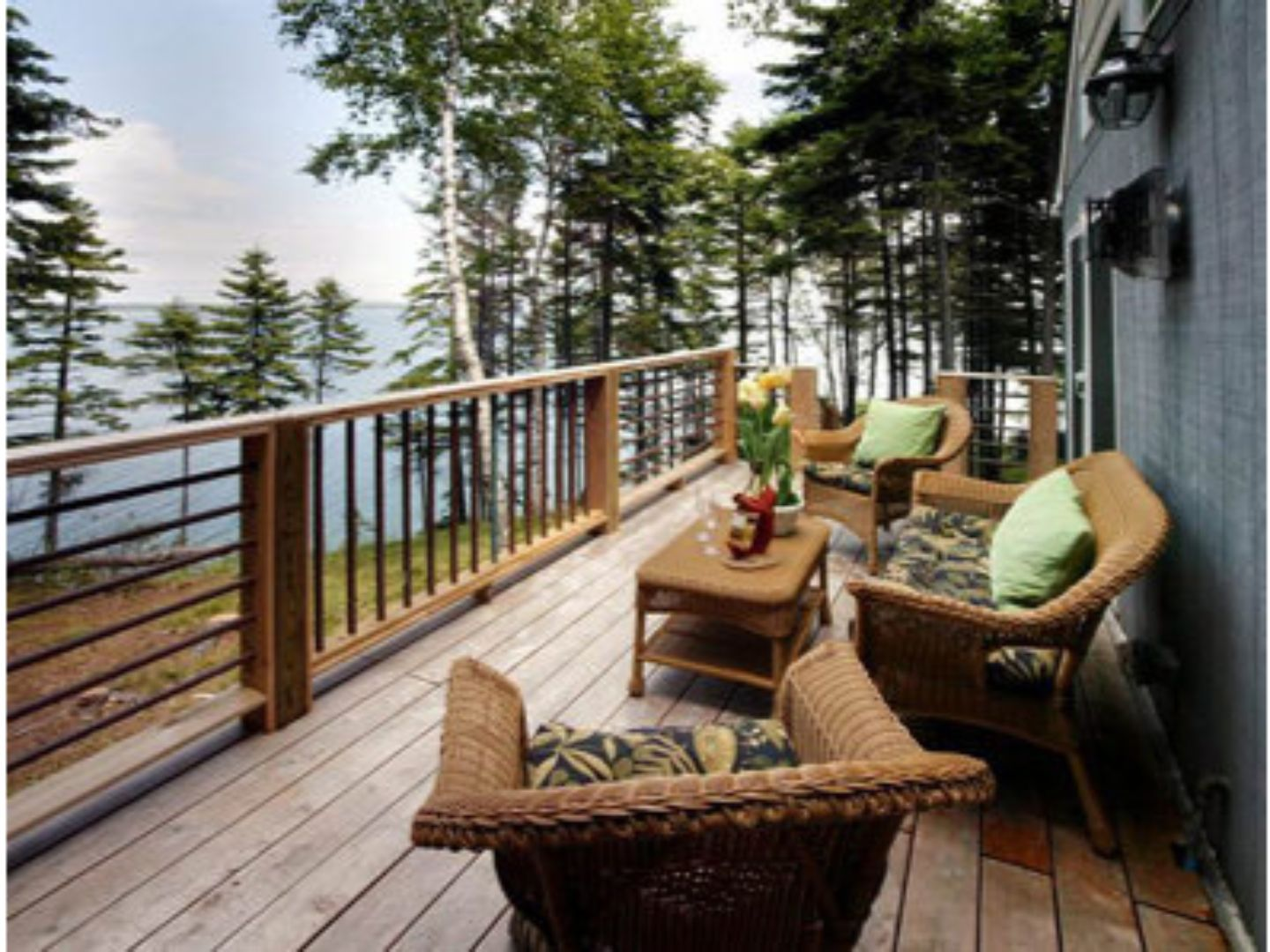 A living room with a wooden fence at Inn at Bay Ledge.