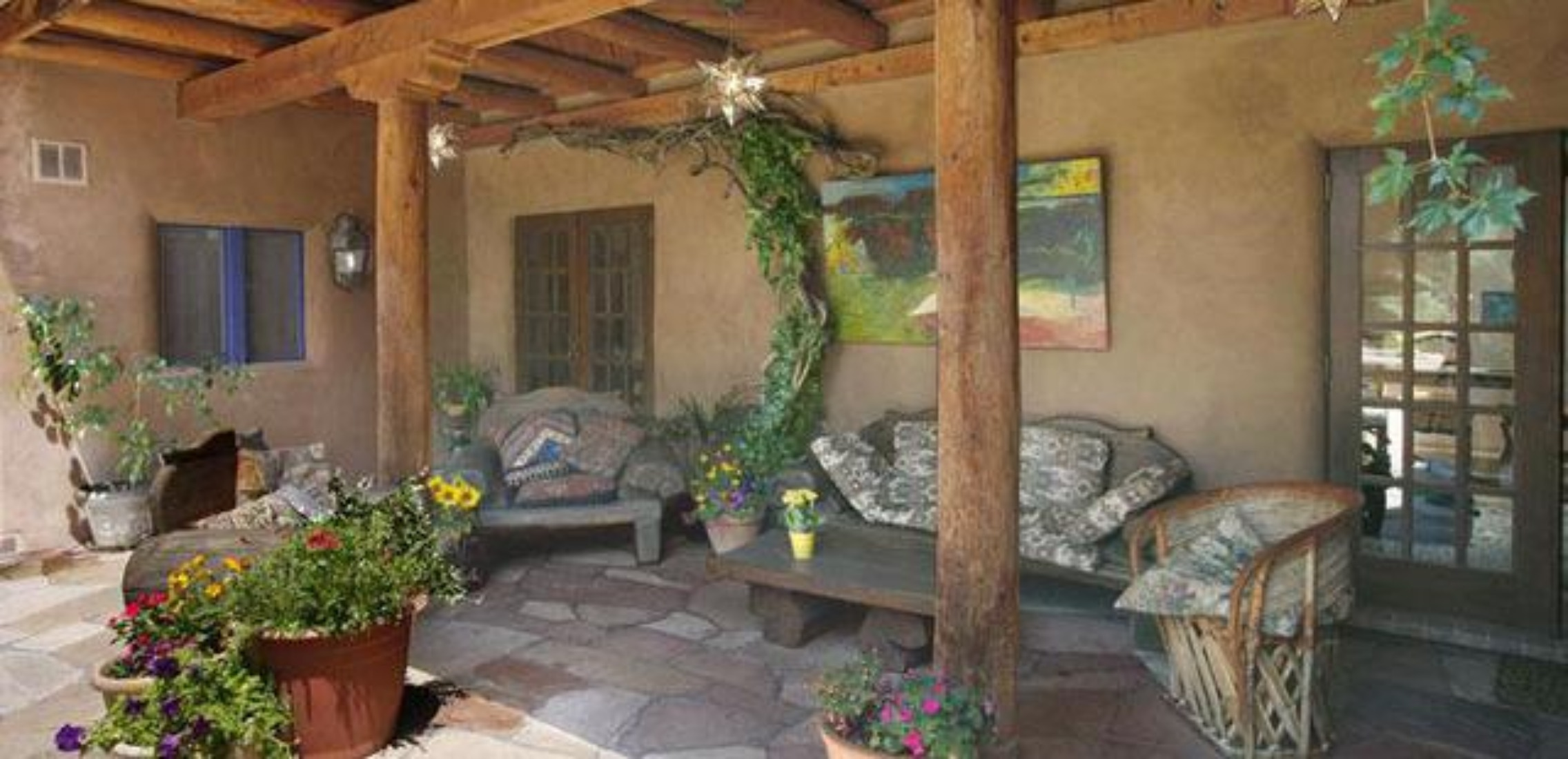 A living room filled with furniture and a fire place at Hacienda Nicholas Bed & Breakfast Inn.