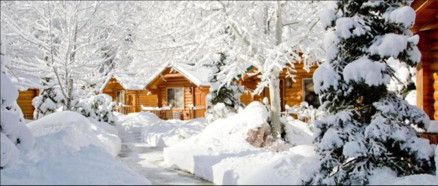 A house covered in snow at Alaskan Inn.