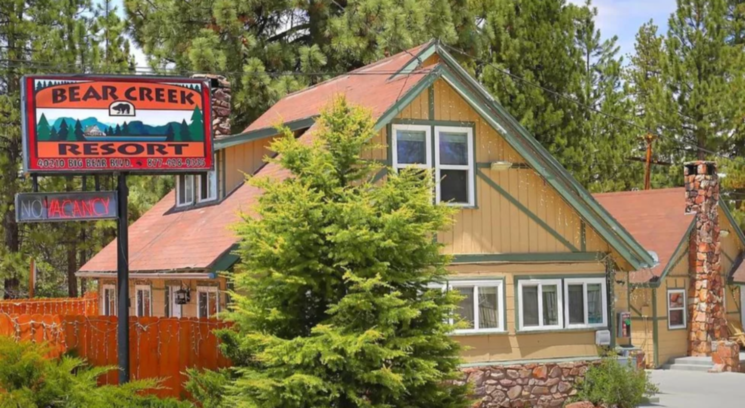 A house that has a sign on the side of a building at Bear Creek Resort.