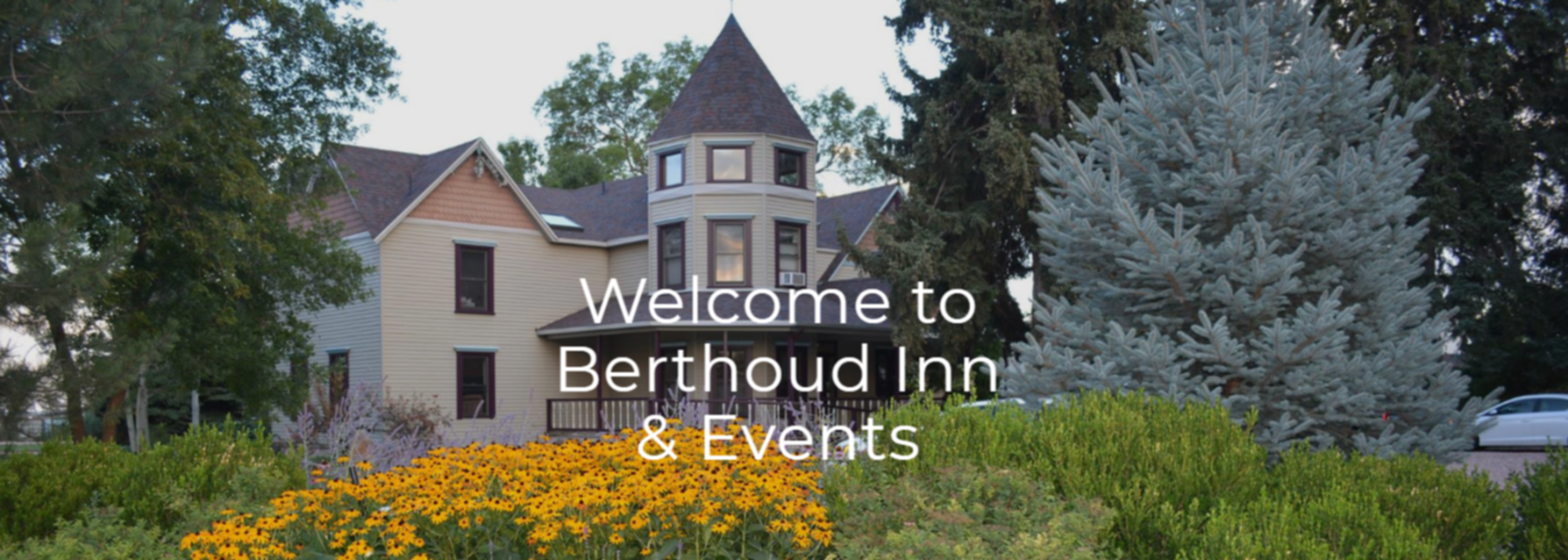 A sign in front of a house at Berthoud Inn and Events.