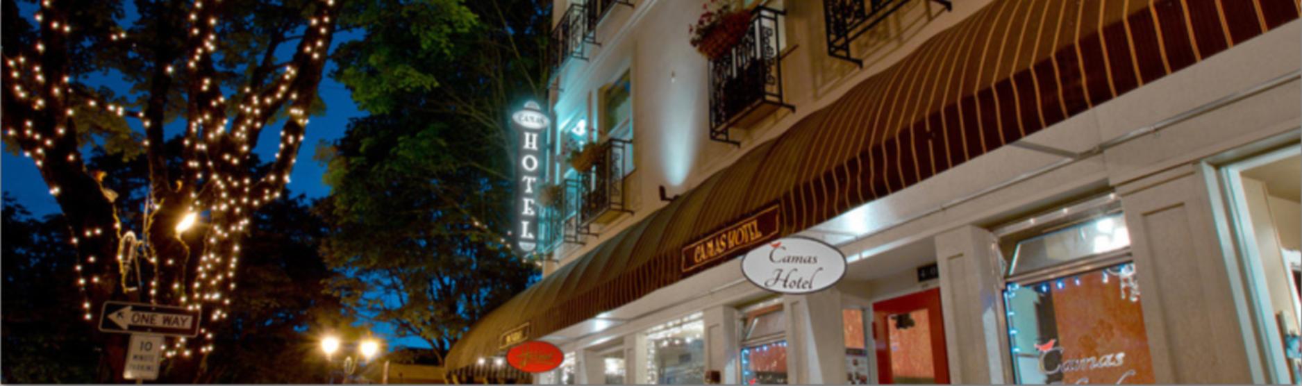 A sign above a store at Camas Hotel.