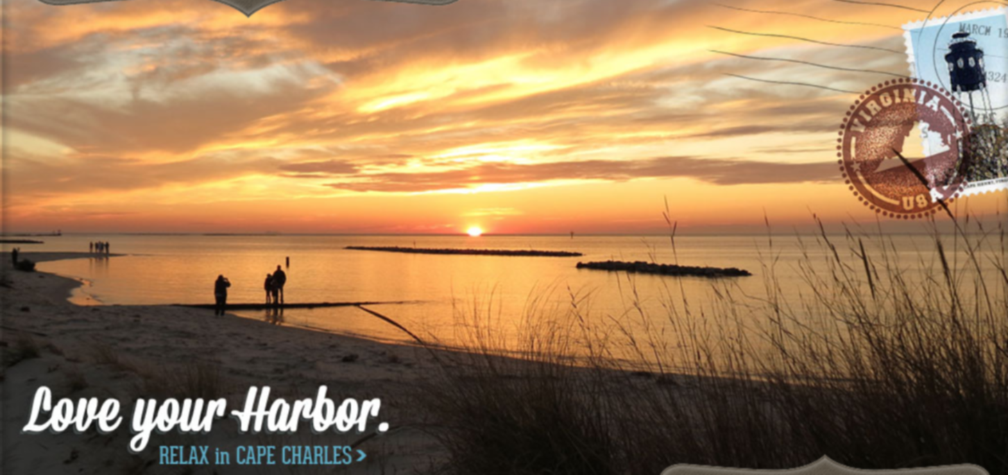 A sunset over a body of water at Cape Charles House Bed & Breakfast.