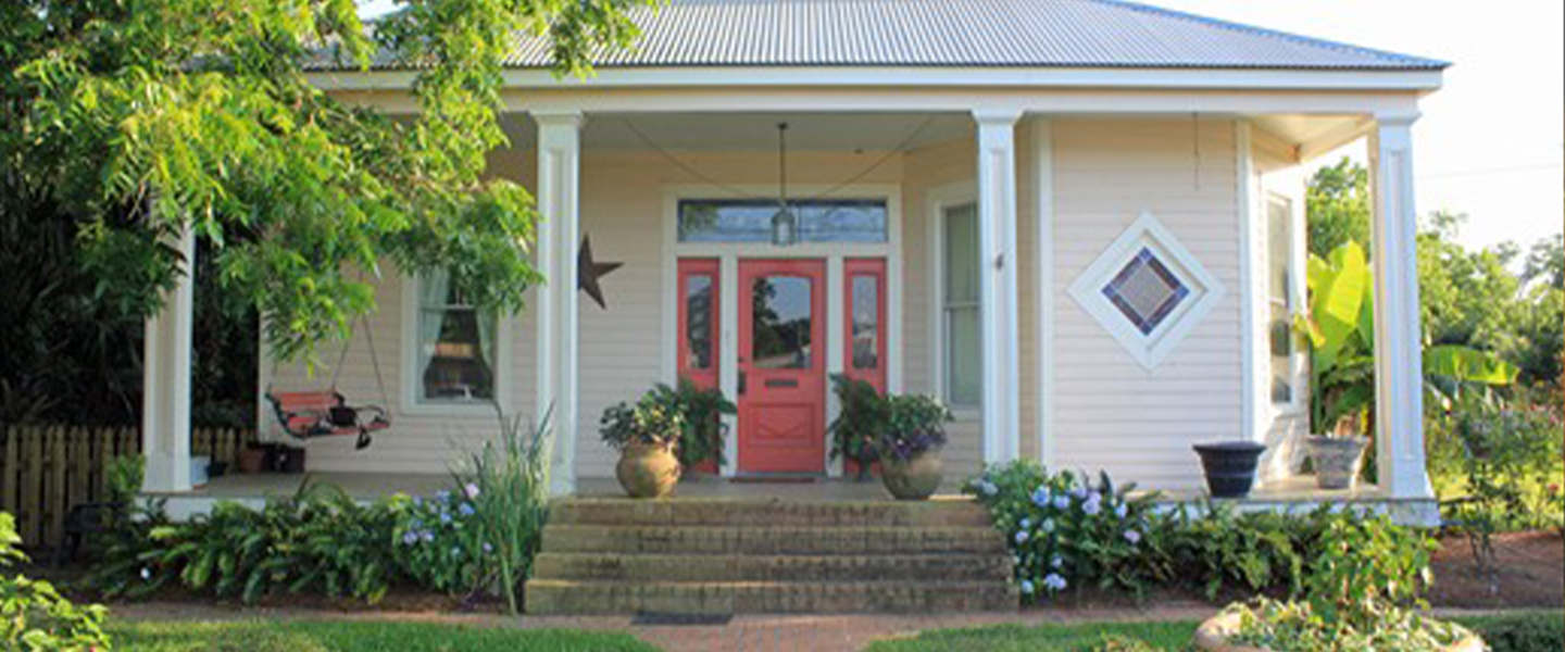 A person standing in front of a house at Carroll House Bed & Breakfast.