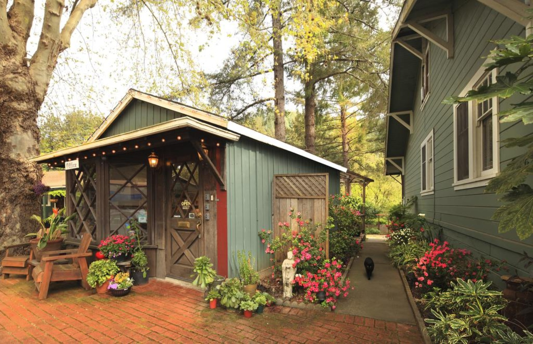 A close up of a flower garden in front of a house at Inn on the Russian River.