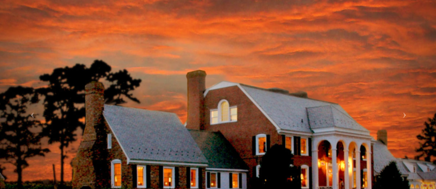 A house with a sunset in the background at KingsBay Mansion.