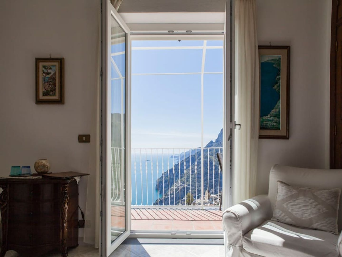 A bedroom with a large window at B&B Mamma Rosa .