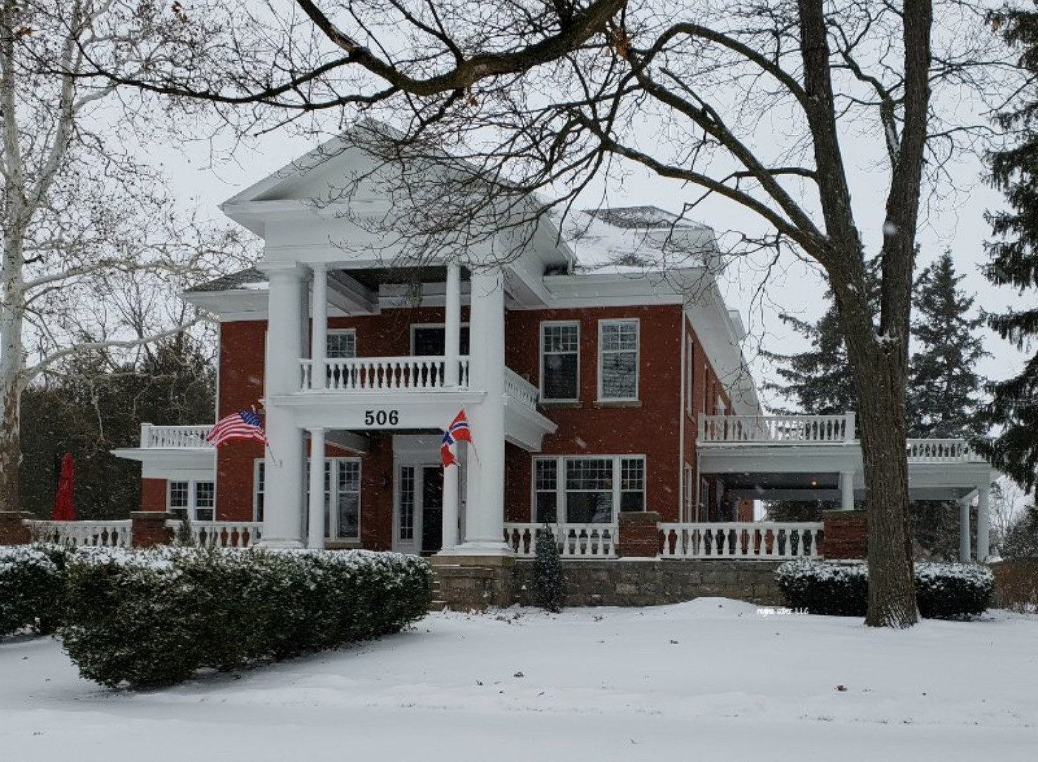 A house covered in snow at The Nordic Pineapple Bed and Breakfast.