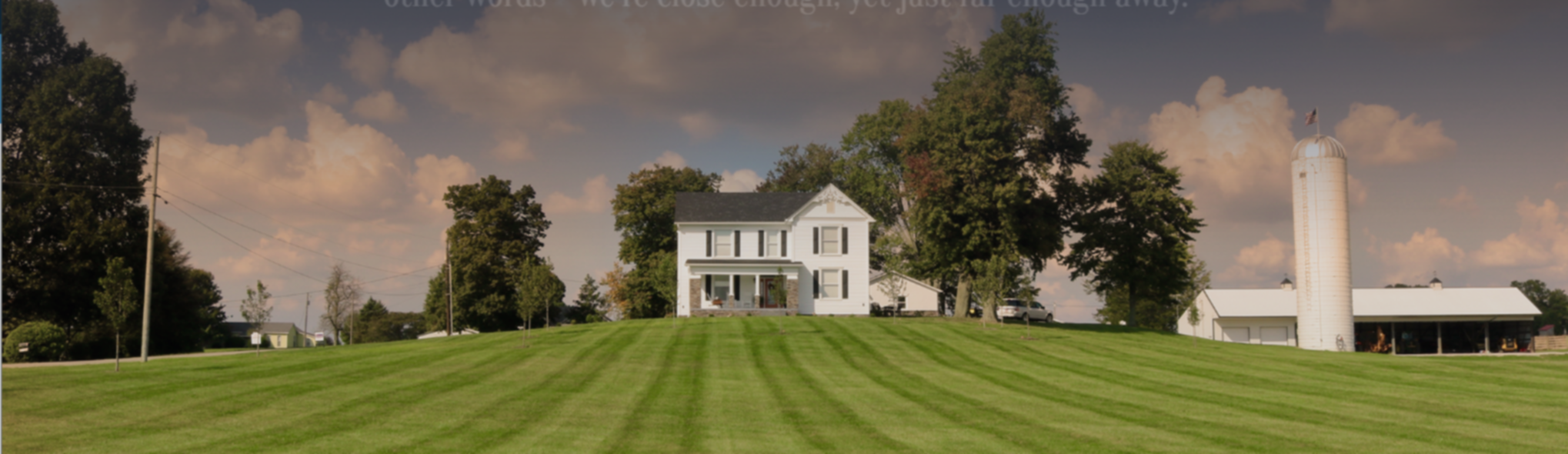 A house with a grass field at The Old Farmhouse B&B.