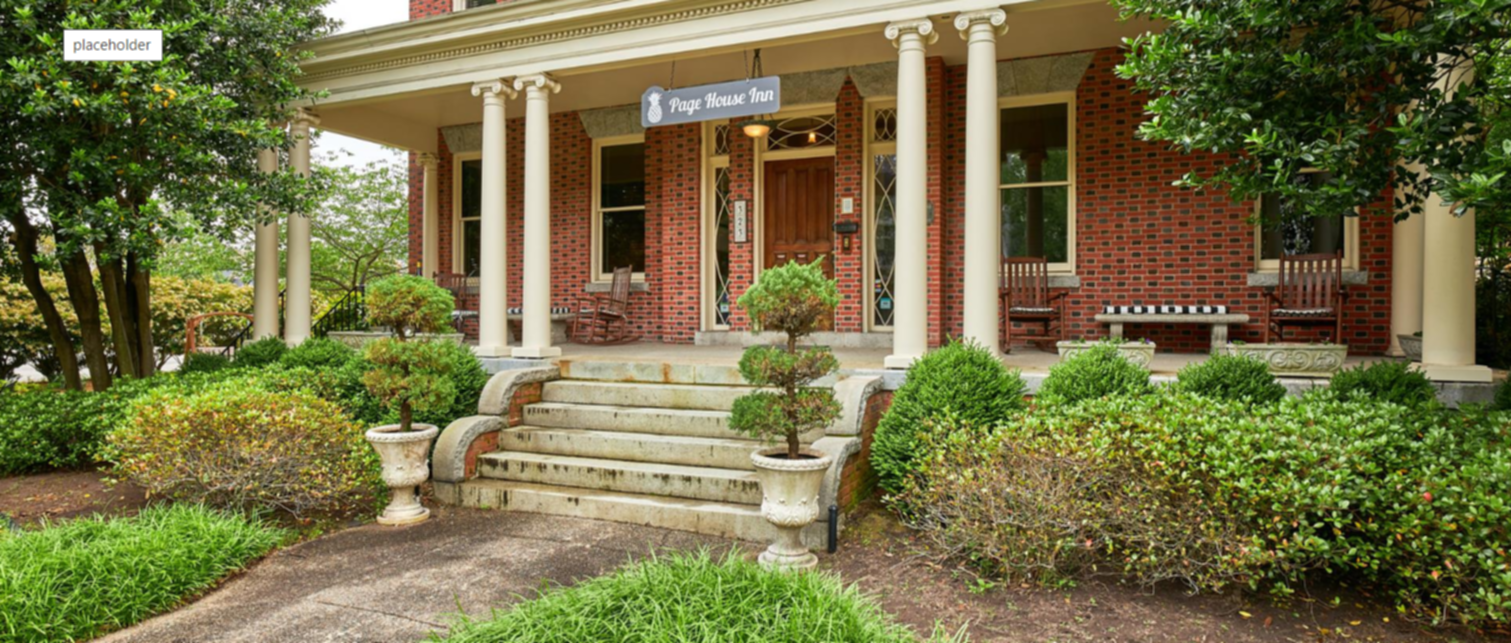 A bench in front of a building at innkeeper@pagehouseinn.com.