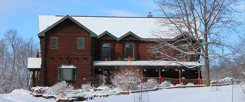 A house covered in snow at Silver Star B&B Inn.