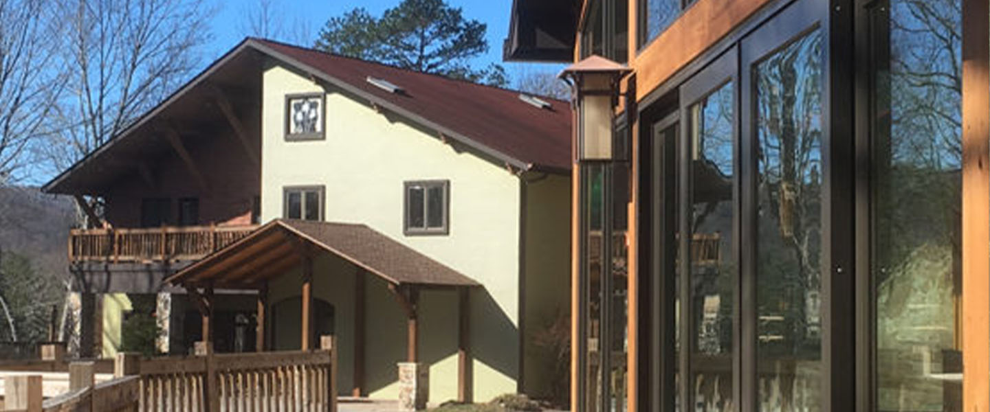 A house that has a sign on the side of a building at Sylvan Valley Lodge & Cellars.