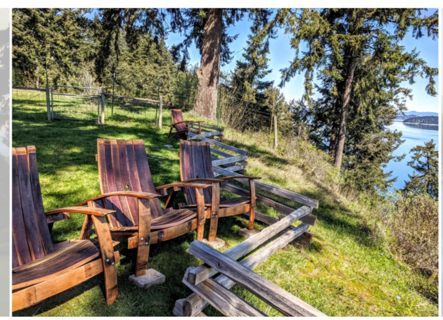 A wooden bench in a park at The Bluff on Whidbey Bed & Breakfast.