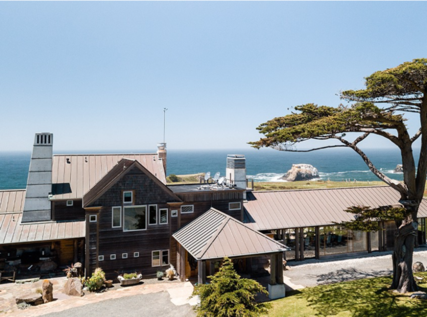 A house with trees in the background at The Inn at Newport Ranch.
