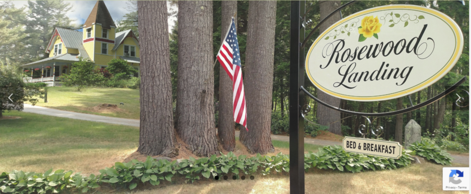 A sign on a pole at The Inn at Rosewood Landing.