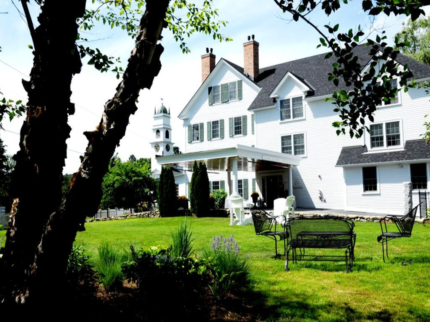 A large lawn in front of a house at The Lyme Inn.