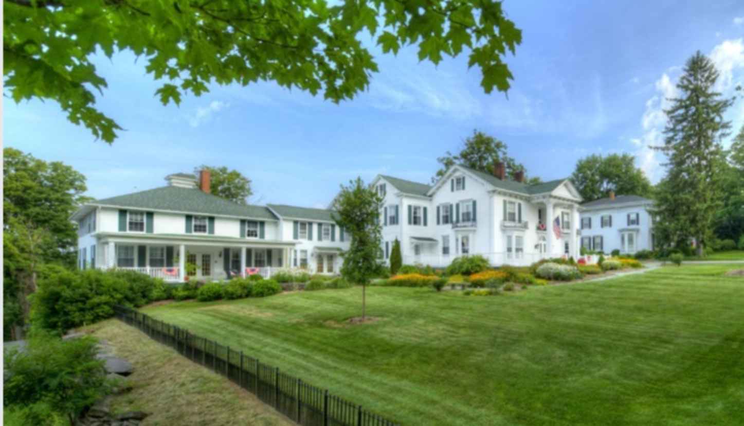 A large lawn in front of a house at The Rosemont Inn B&B.