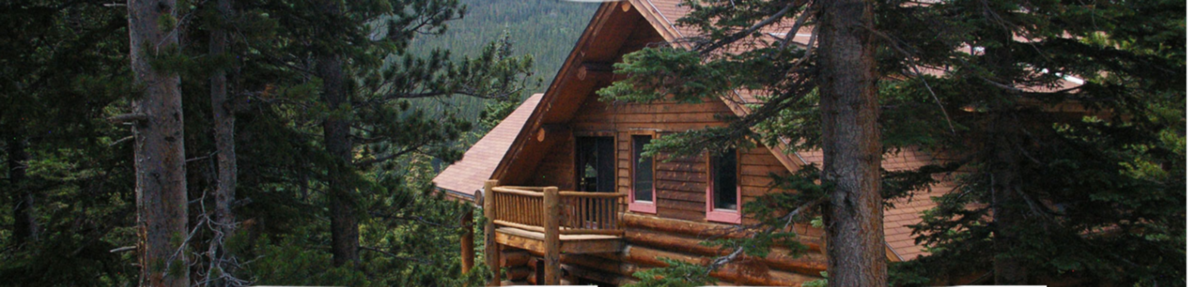 A house with trees in the background at The Silver Lake Lodge.