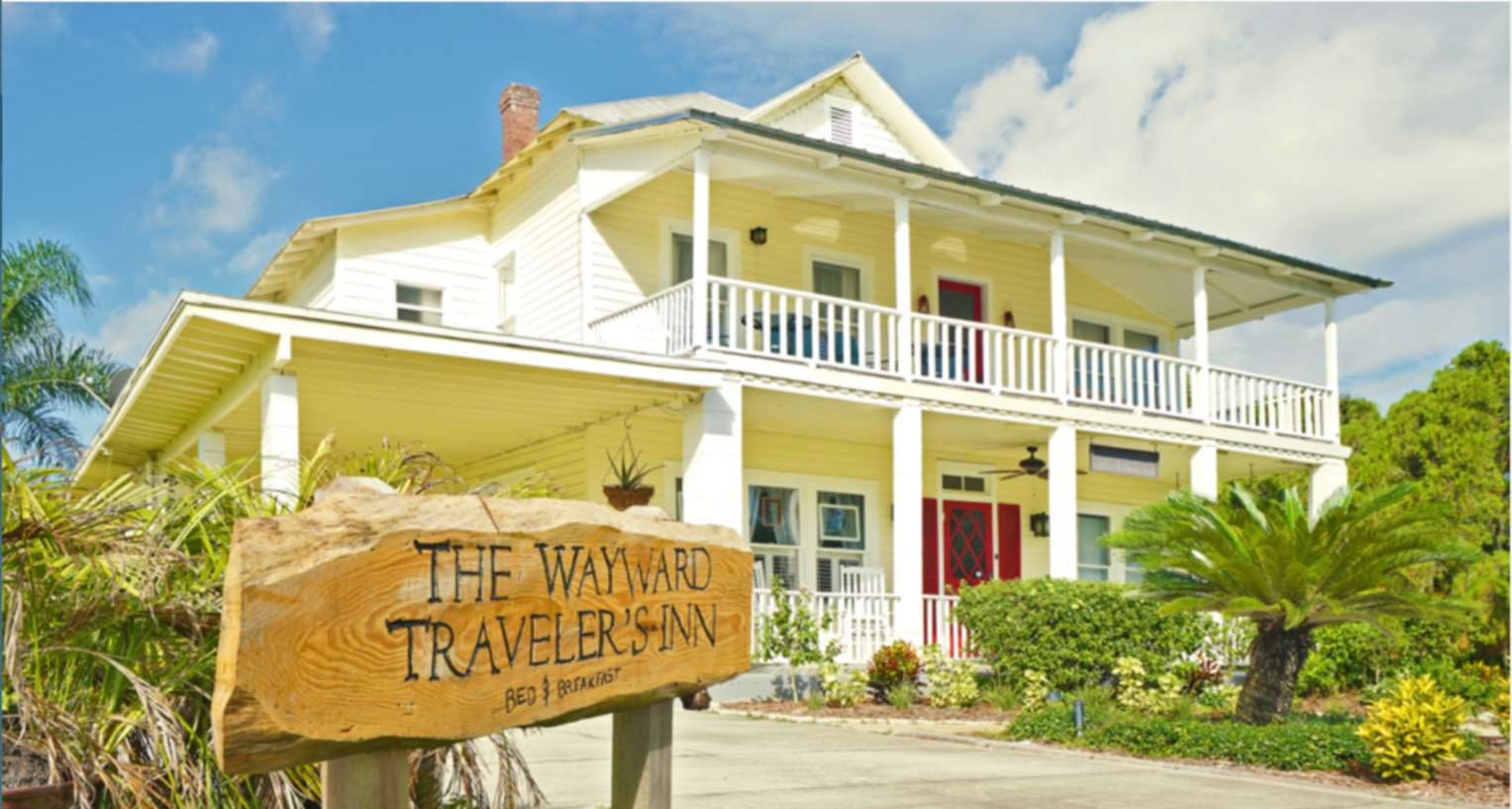 A sign on the side of a building at The Wayward Traveler's Inn.