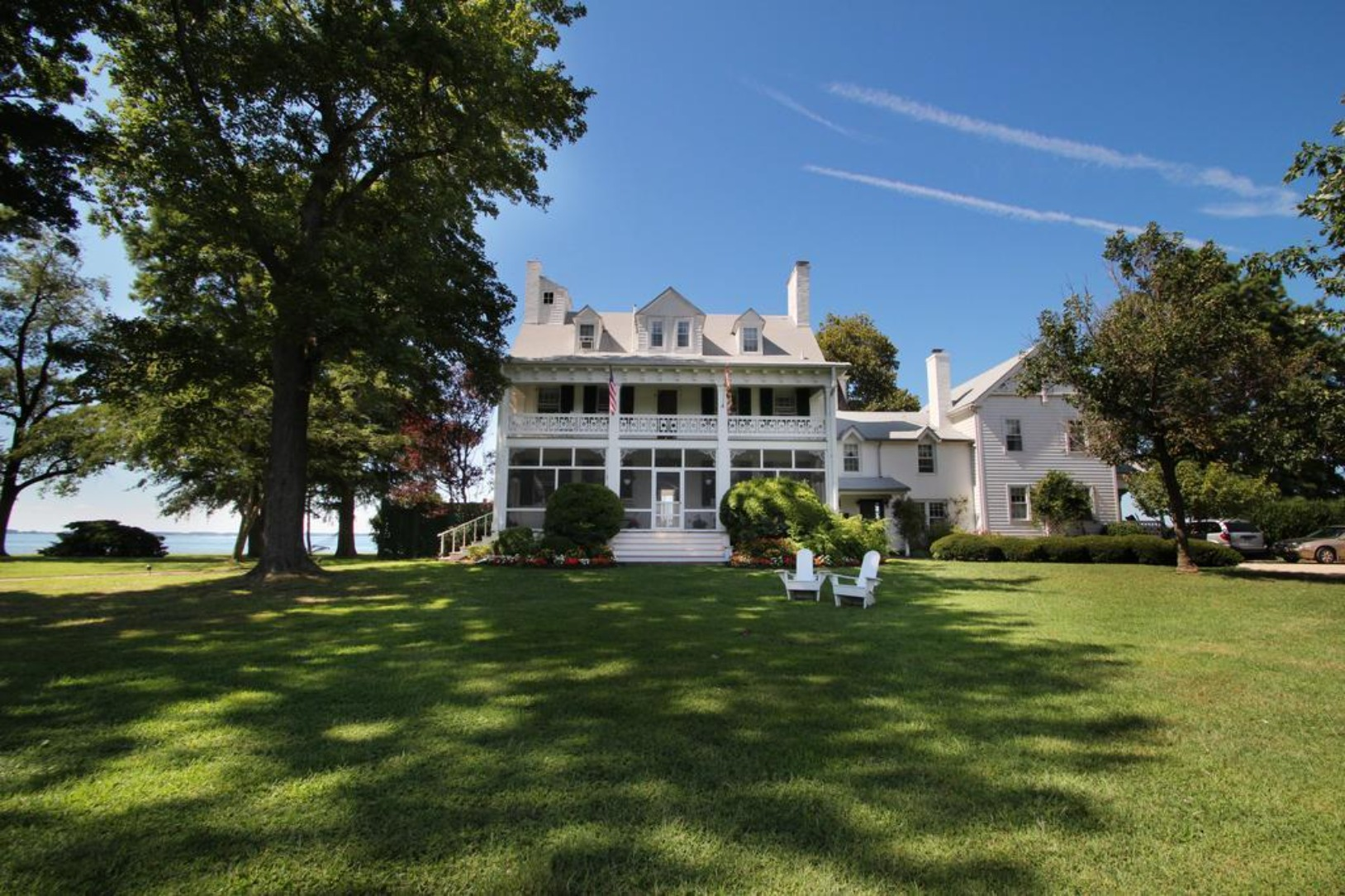 A large lawn in front of a house at Wades Point Inn.
