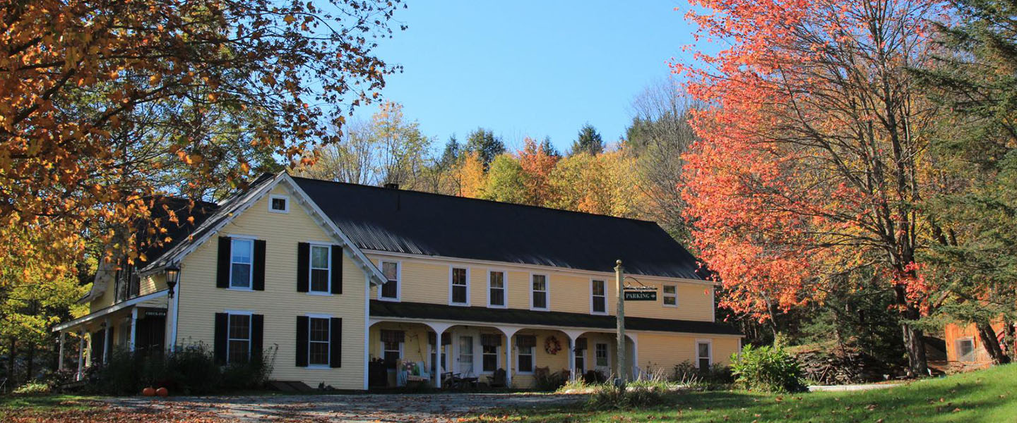 A tree in front of a house at Wilder Farm Inn.