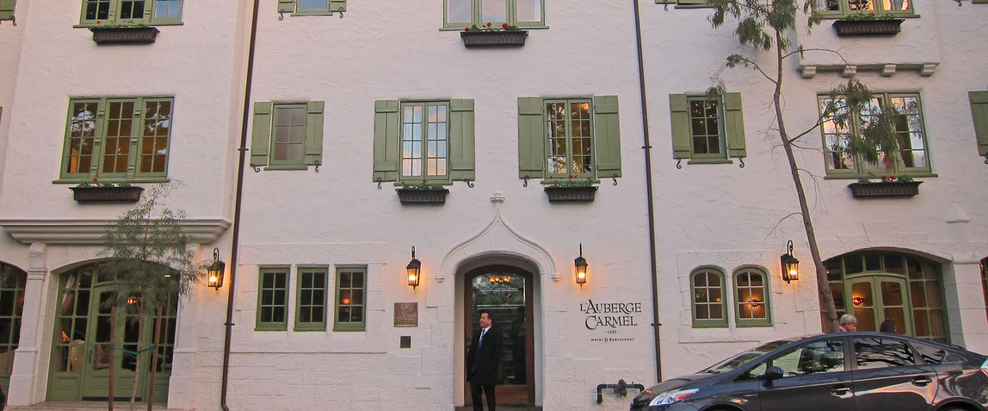 A large building with many windows at L'Auberge Carmel.