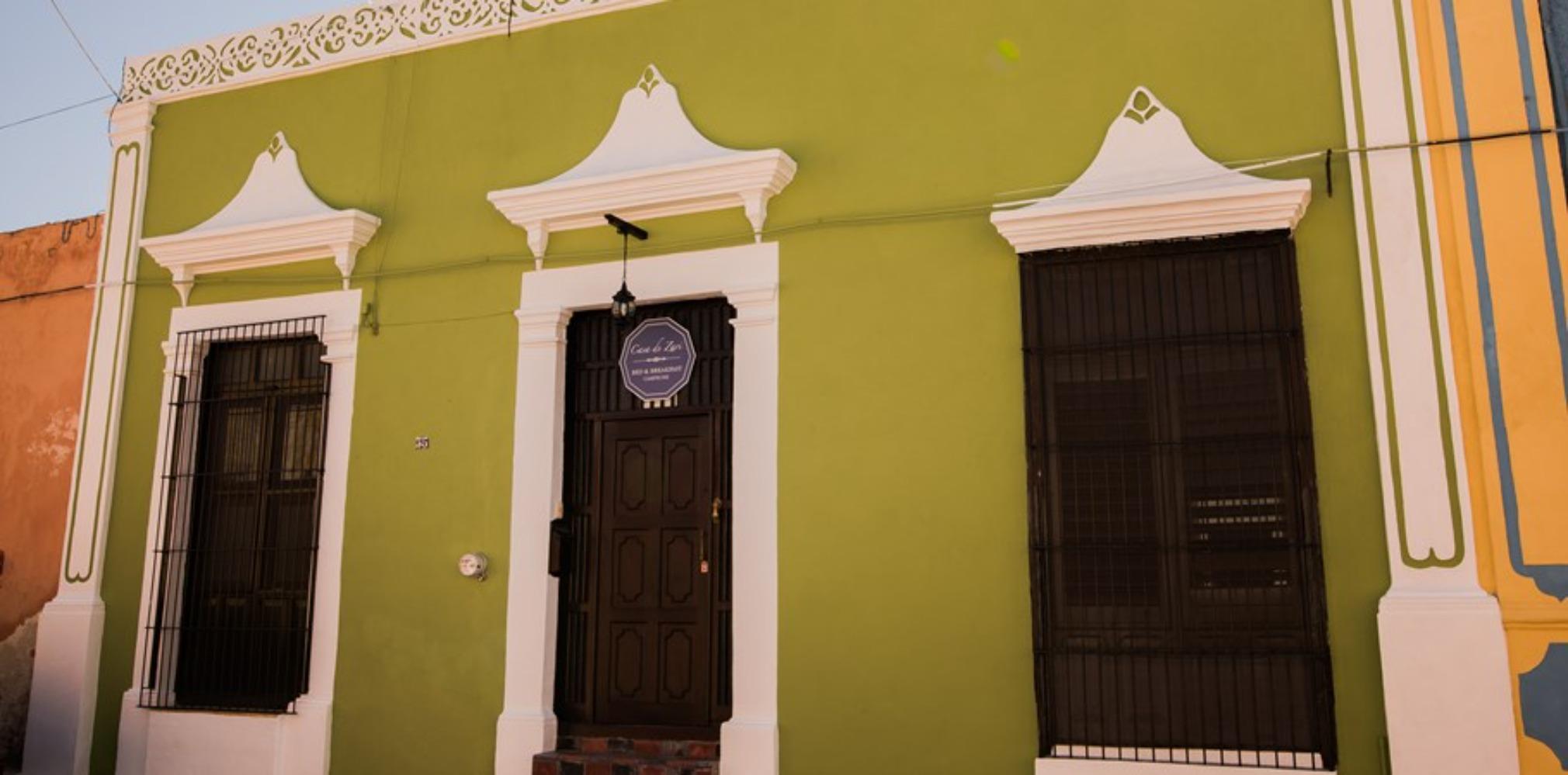 A close up of a yellow building at Casa de Zari B&B.