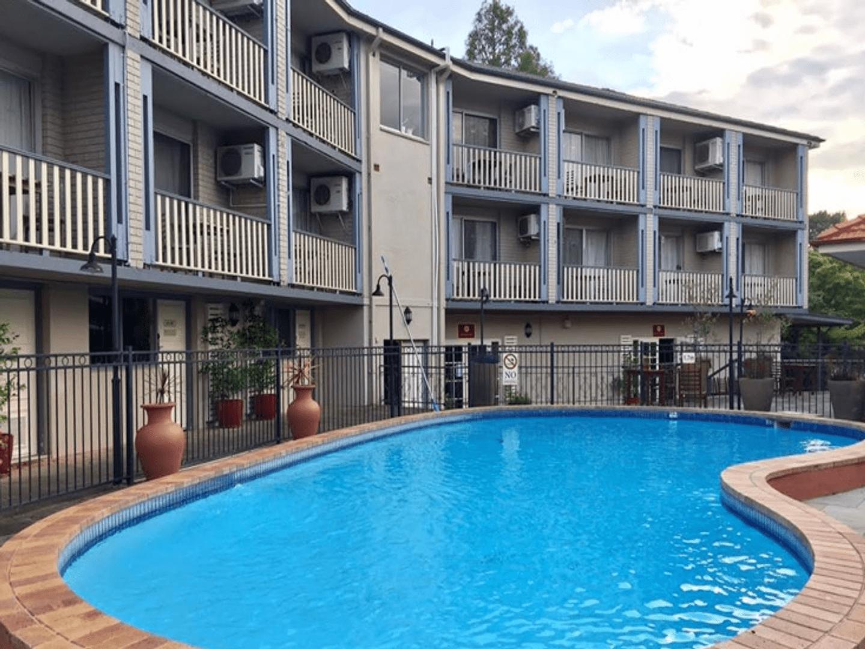 A large pool of water at Leura Gardens B&B Resort.