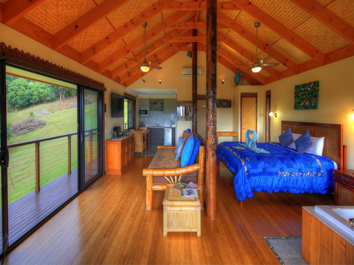 A bedroom with a wooden table at Maleny Tropical Retreat.