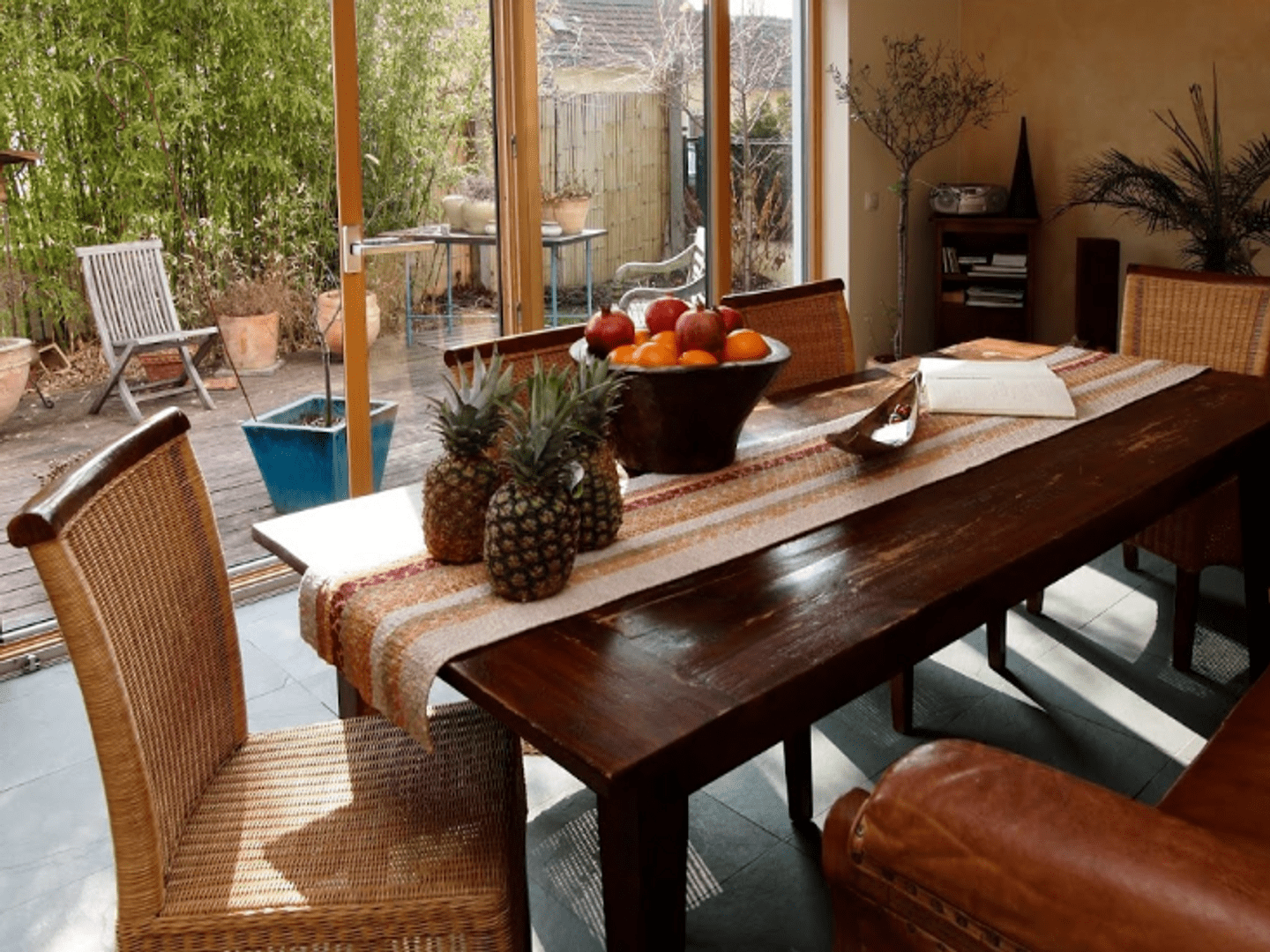 A wooden dining table at The Rooms Bed & Breakfast.