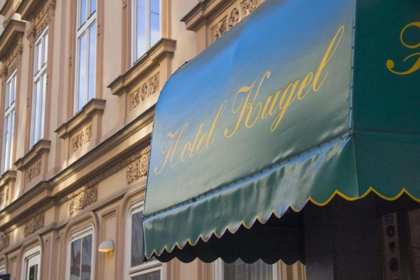 A sign on the side of a building at Hotel Kugel Wien.