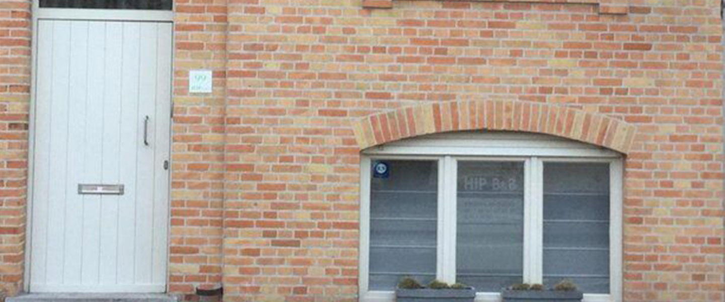 A close up of a brick building at Hip Bed & Breakfast.