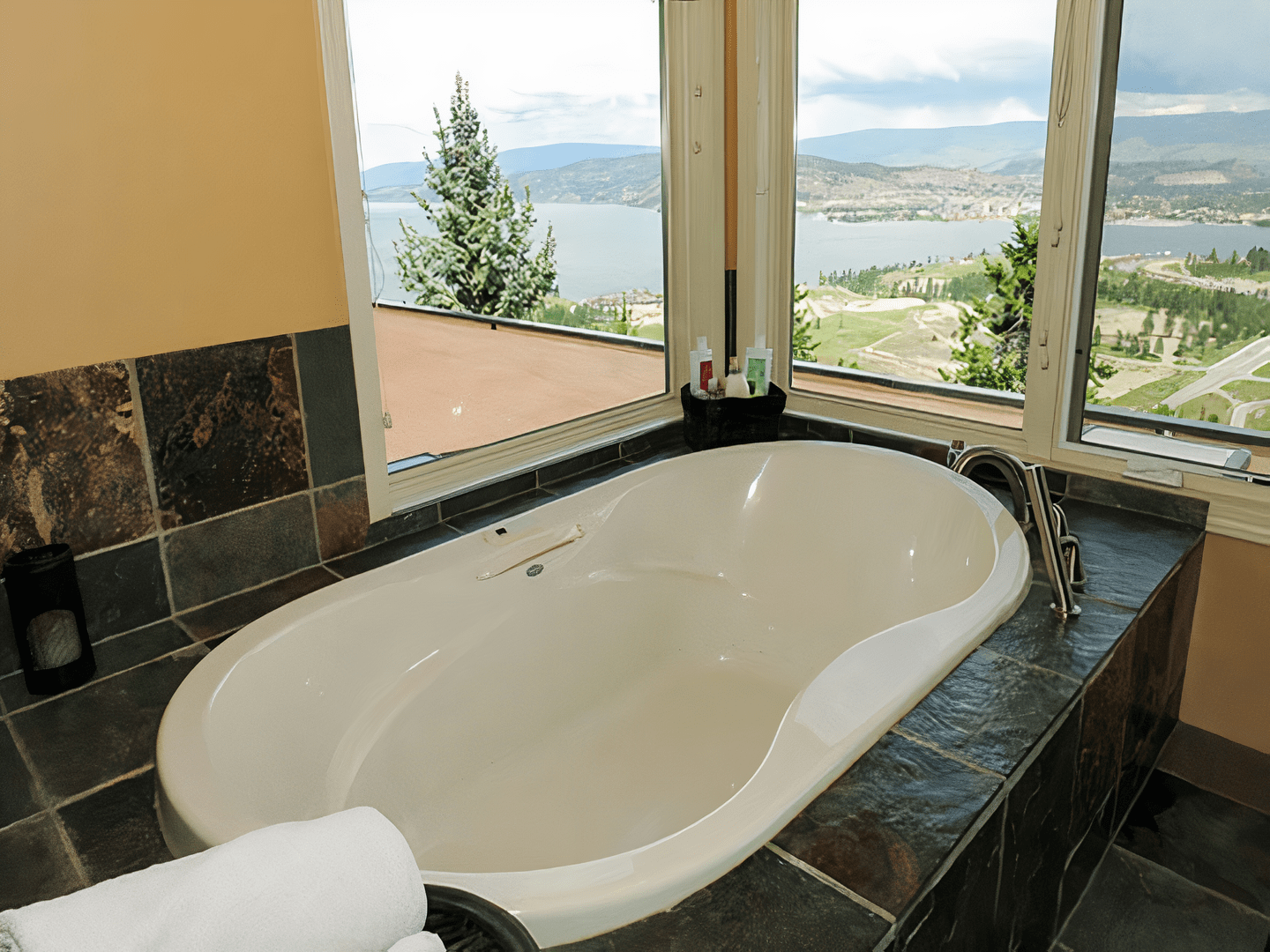 A large white tub sitting next to a sink at A View of the Lake Bed and Breakfast.