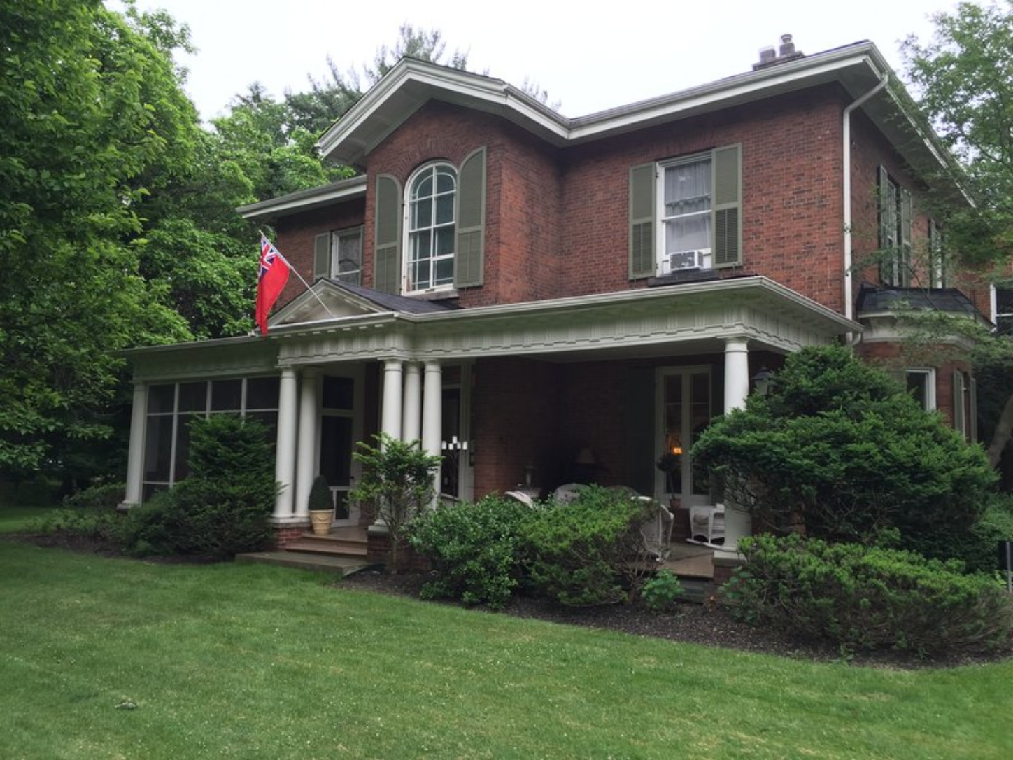 A house with trees in the background at Osler House.
