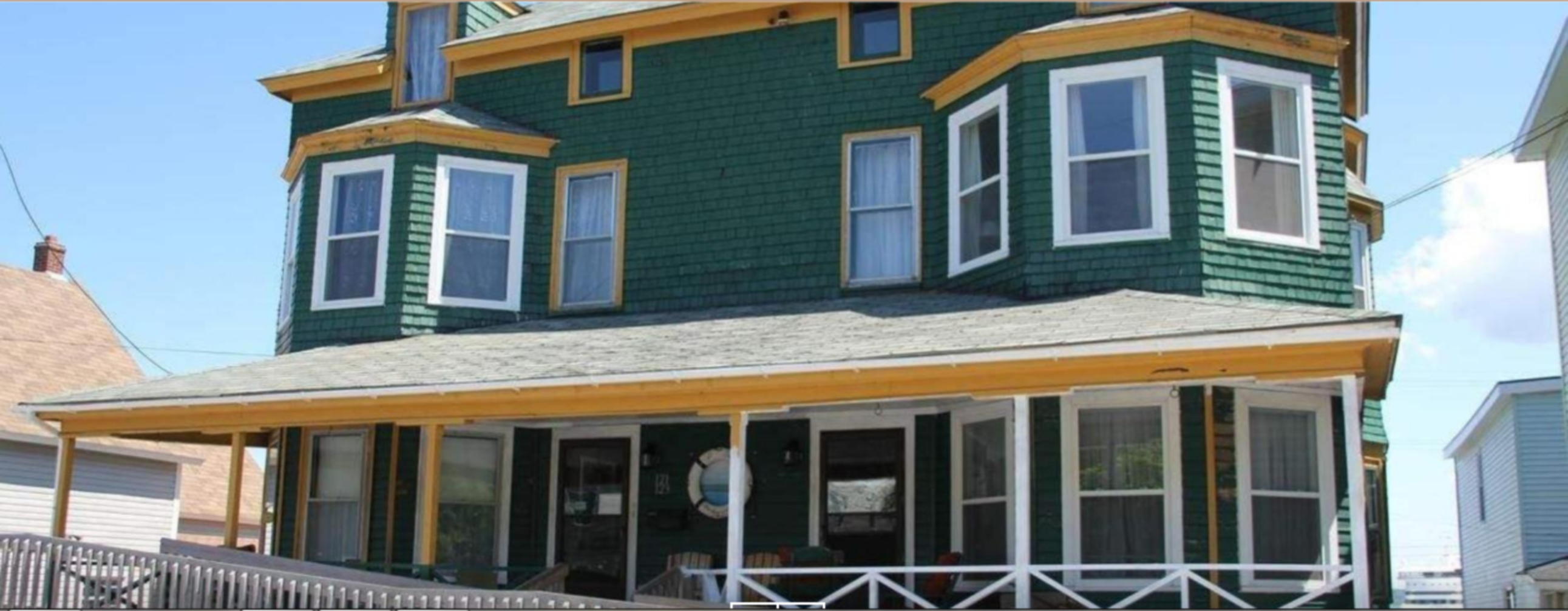 A house with a large window at At The Harbourfront B & B Inn.