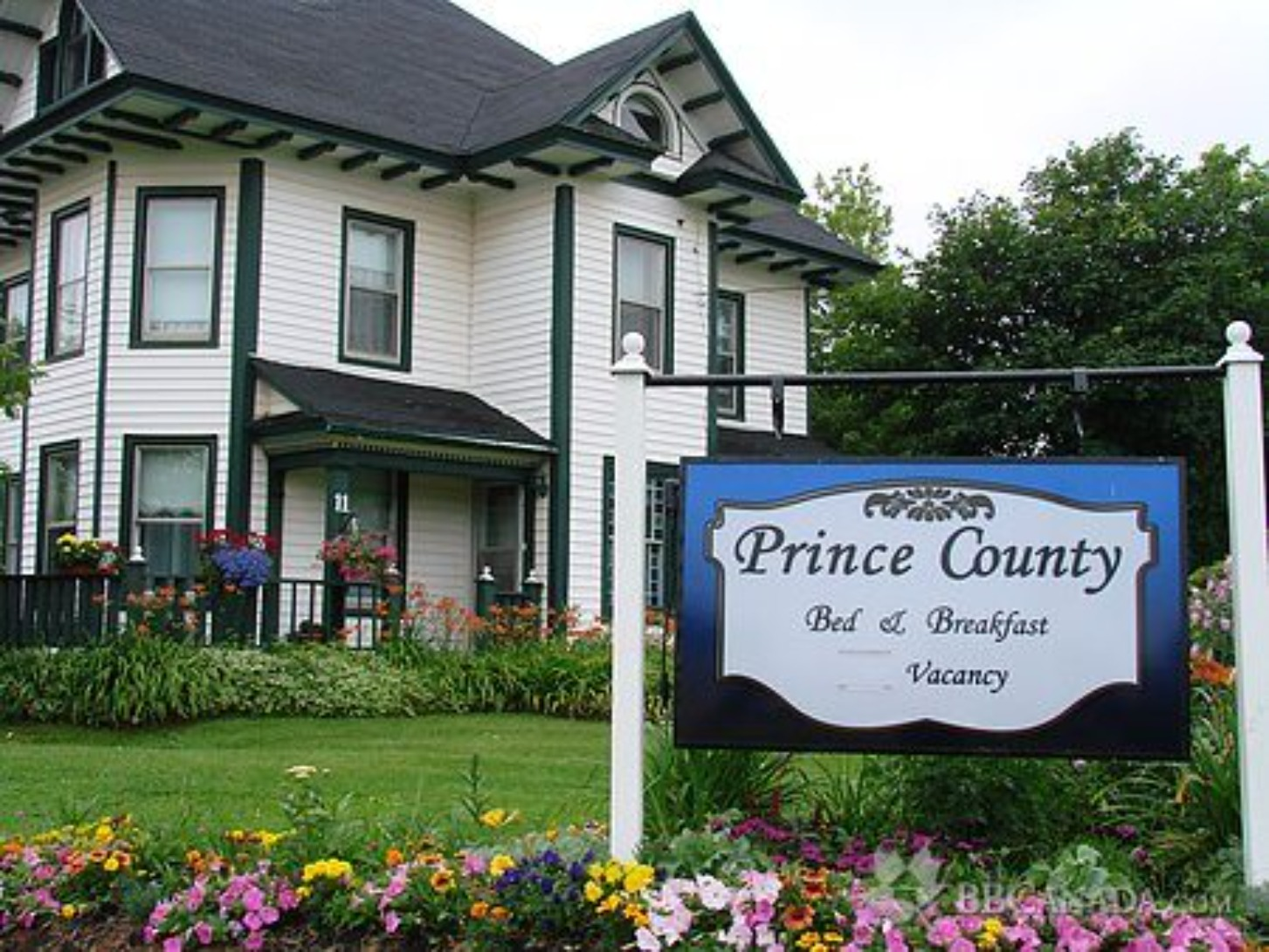 A sign in front of a house at Prince County Bed & Breakfast.
