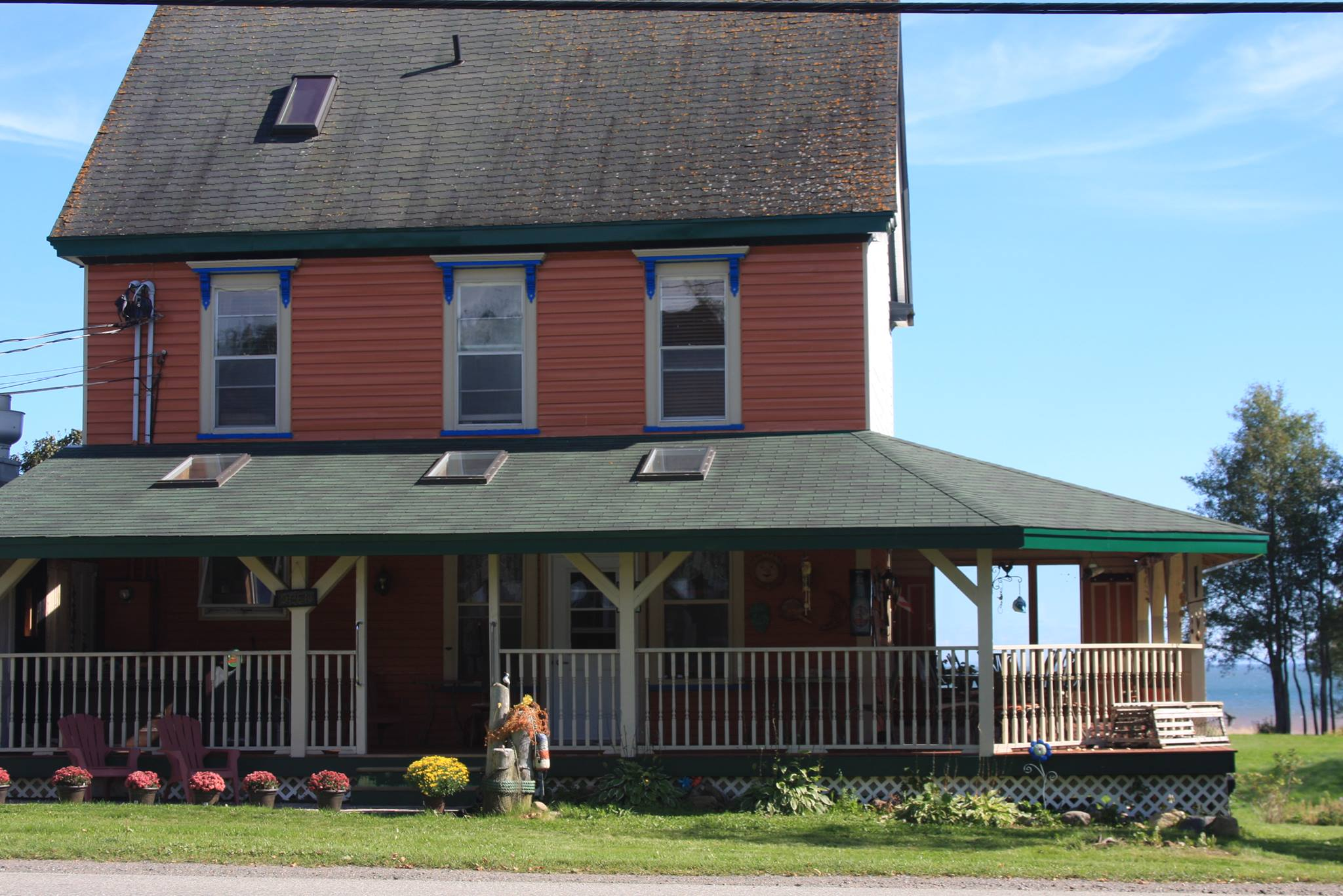 A small house in the background at Salmon River B&B.