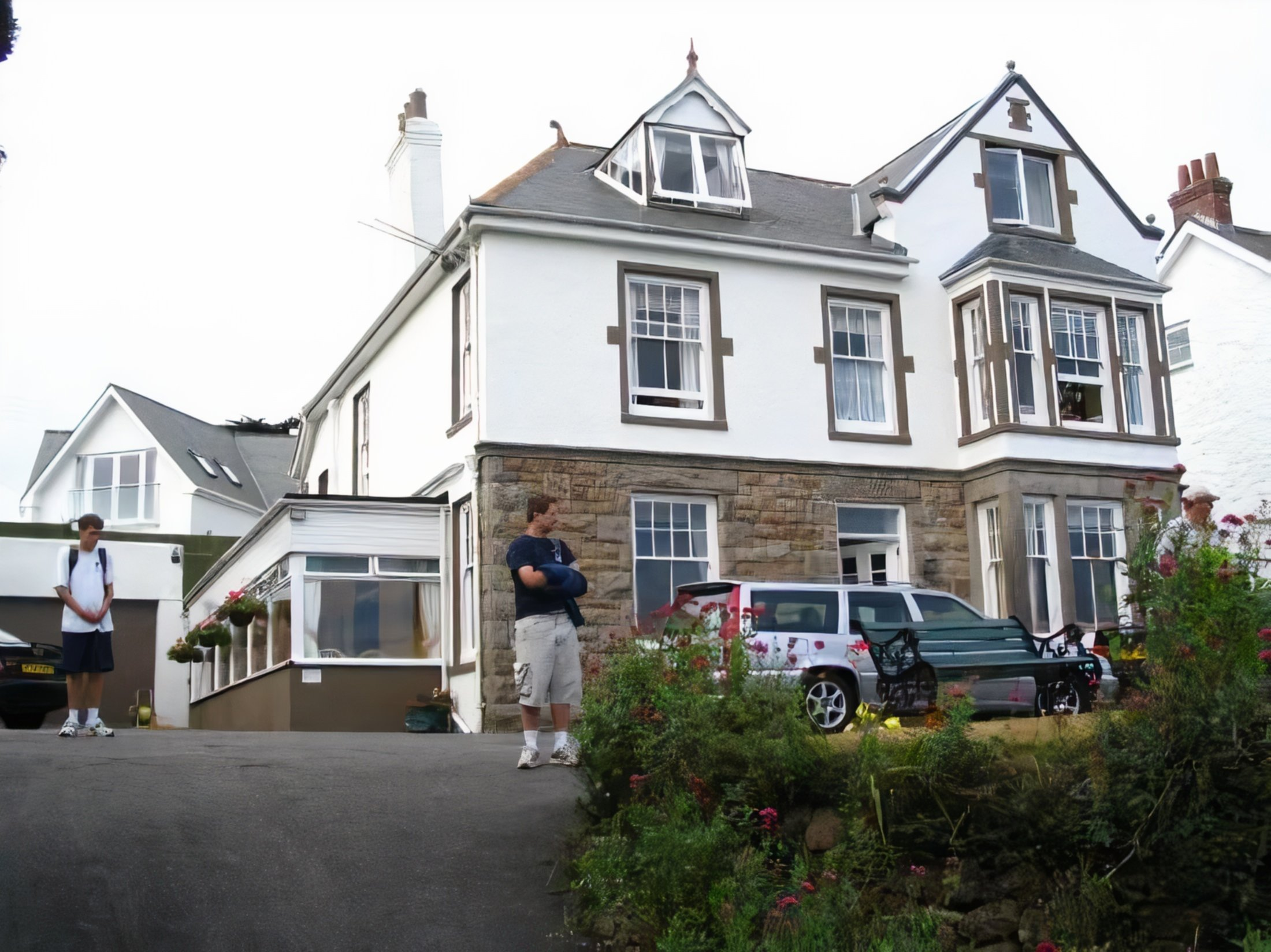 A person standing in front of a house at Borthalan Hotel.
