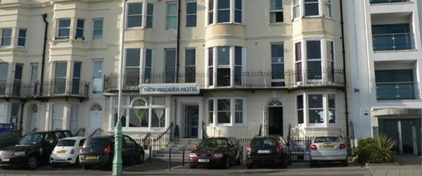 A car parked in front of a building at New Madeira Brighton Seafront Hotel.