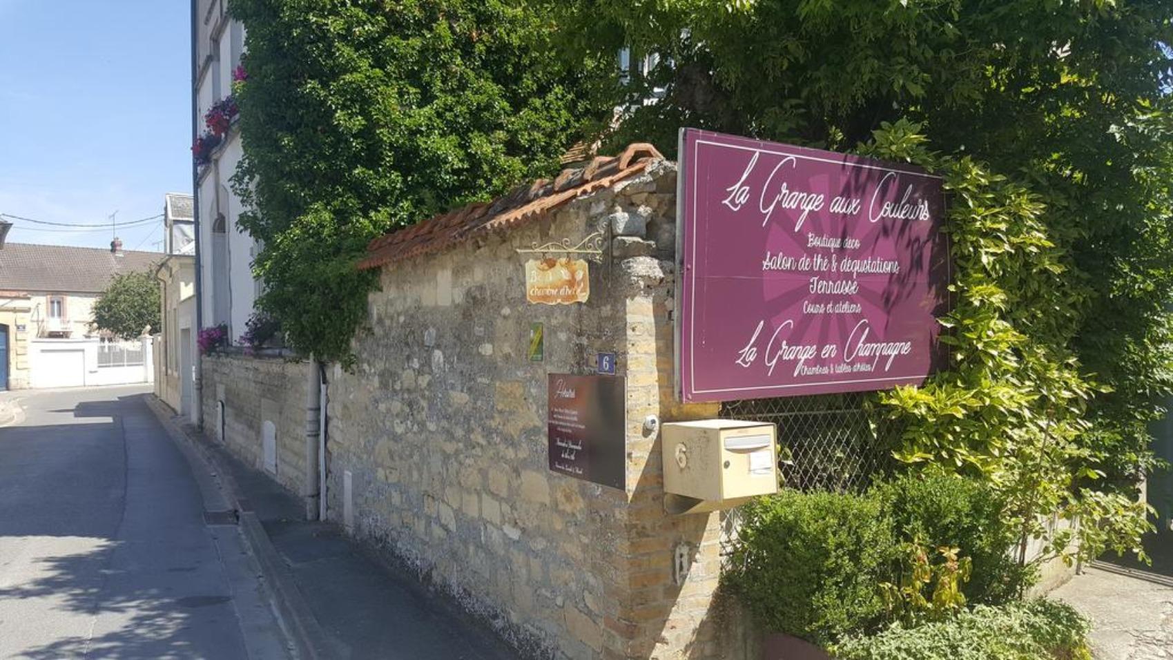 A sign on the side of a road at La Grange en Champagne.