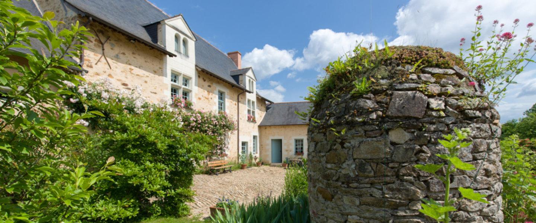 A large stone house at Manoir du Bois de Grez.