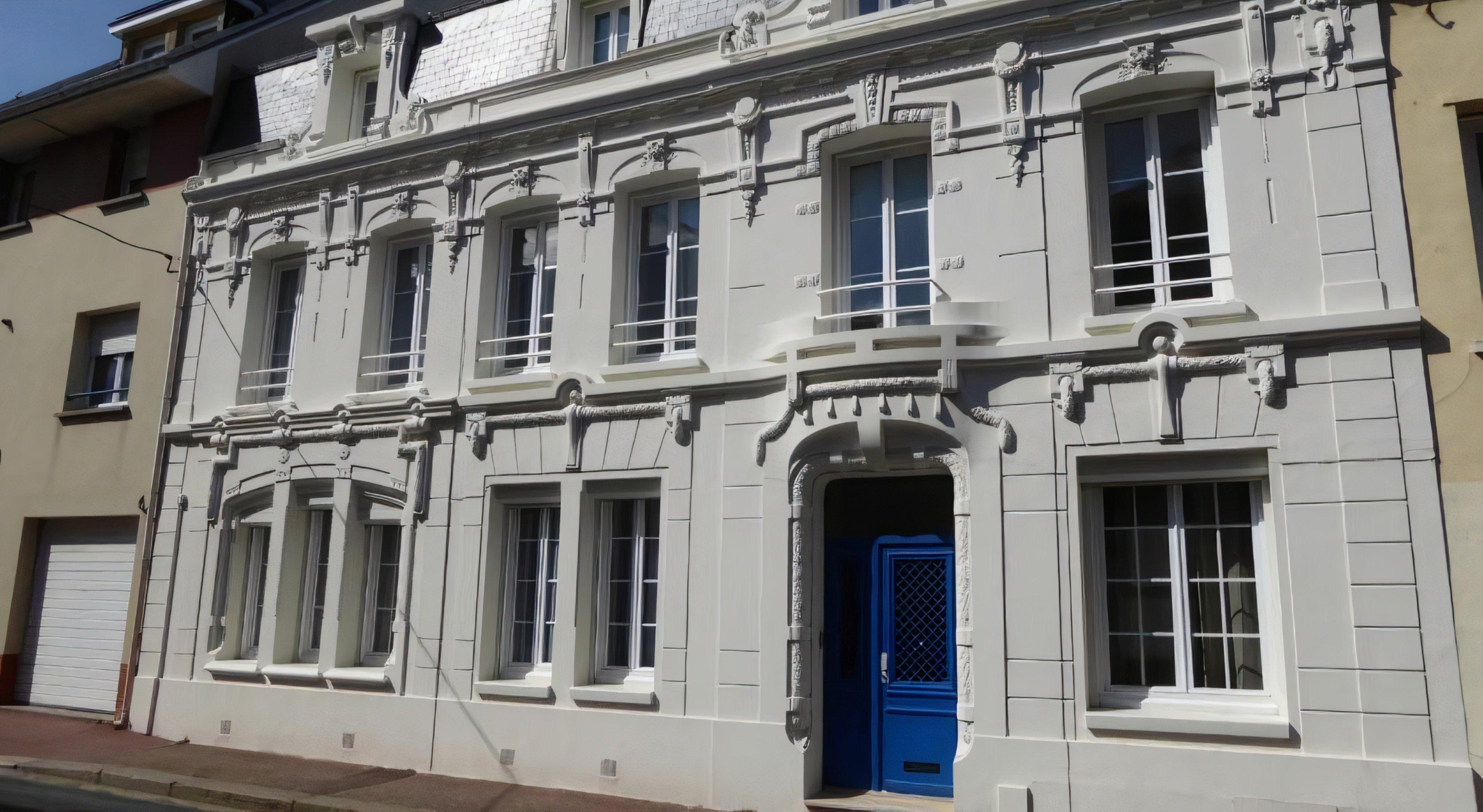 A large white building at A La Maison Blanche.