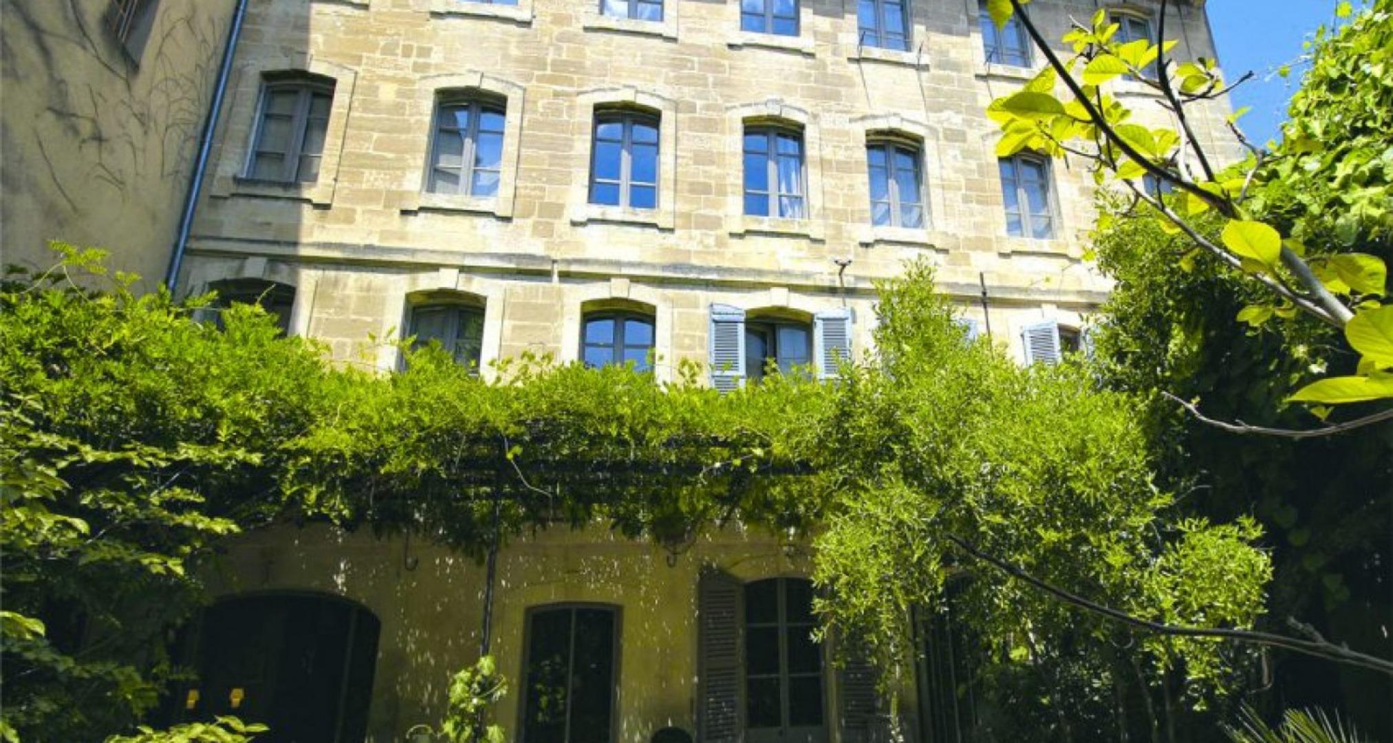 A large brick building at Les Jardins de Baracane.